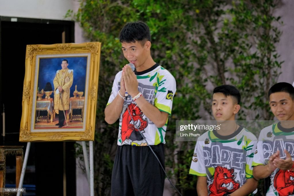 Soccer coach, Ekkapol Chantawong (Centre), and twelve boys from the 'Wild Boars' soccer team arrive for a press conference for the first time since they were rescued from a cave in northern Thailand last week, on July 18, 2018 in Chiang Rai, Thailand. The 12 boys, aged 11 to 16, and their 25-year-old coach were discharged early from Chiang Rai Prachanukroh hospital after a speedy recovery and thanked those involved in their rescue.