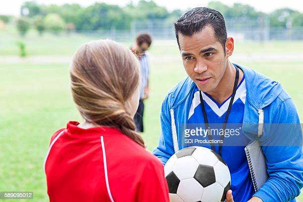 Soccer coach encourages player before game