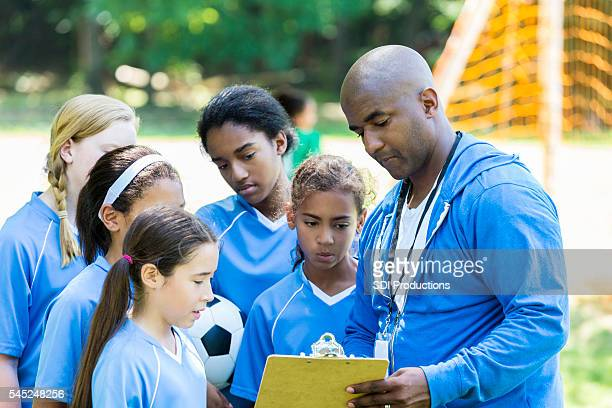 Soccer coach showing a play to his team