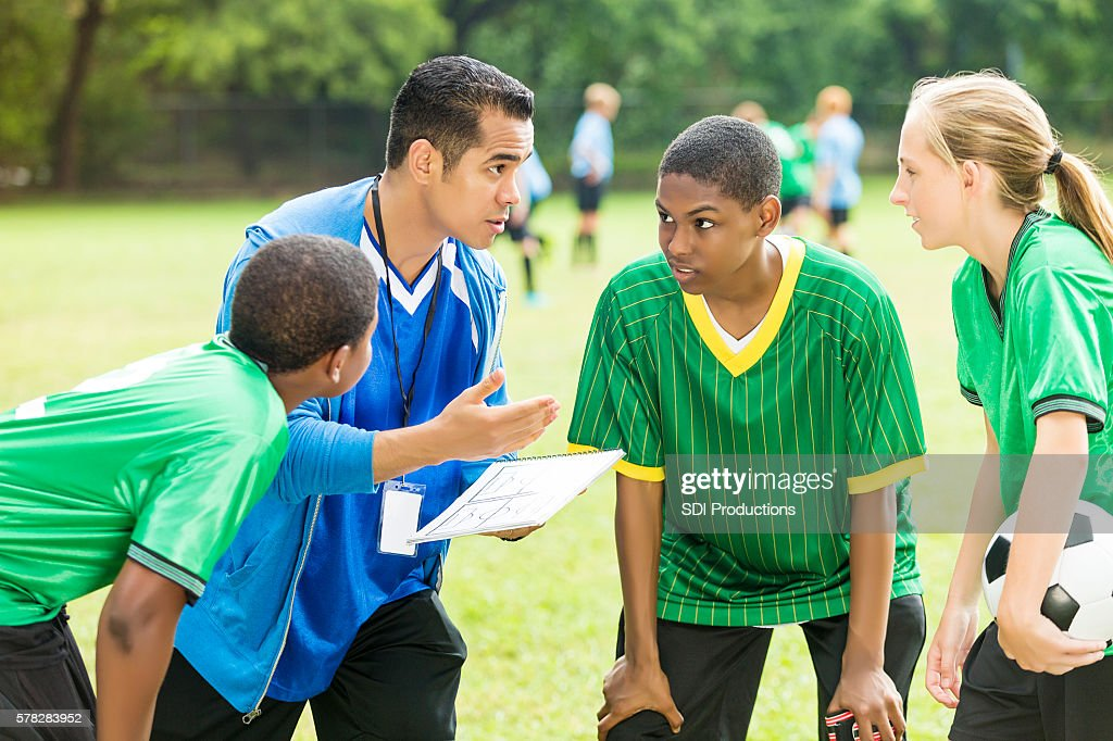 Soccer coach talks about play during time out : Stock Photo