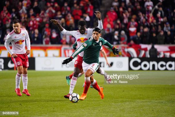 CONCACAF Champions League Club Deportivo Guadalajara Alan Pulido in action vs New York Red Bulls Kemar Lawrence during second leg of semifinal at Red...