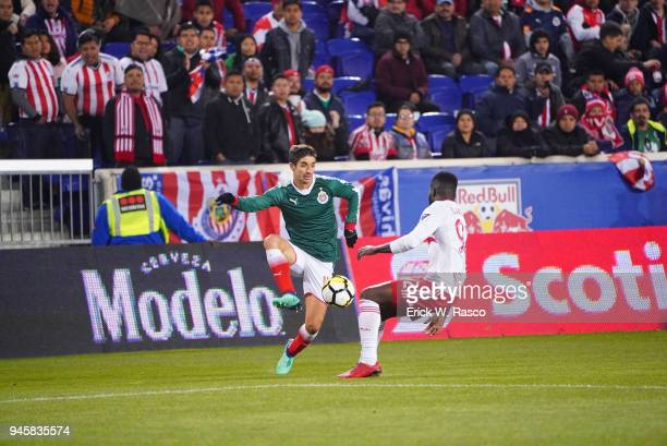 CONCACAF Champions League Club Deportivo Guadalajara Isaac Brizuela in action vs New York Red Bulls Kemar Lawrence during second leg of semifinal at...