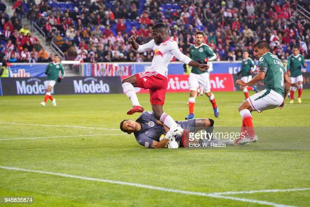 CONCACAF Champions League New York Red Bulls Kemar Lawrence in action vs Club Deportivo Guadalajara goalie Rodolfo Cota making save during second leg...