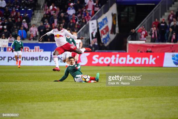 CONCACAF Champions League New York Red Bulls Kemar Lawrence in action vs Club Deportivo Guadalajara Isaac Brizuela during second leg of semifinal at...