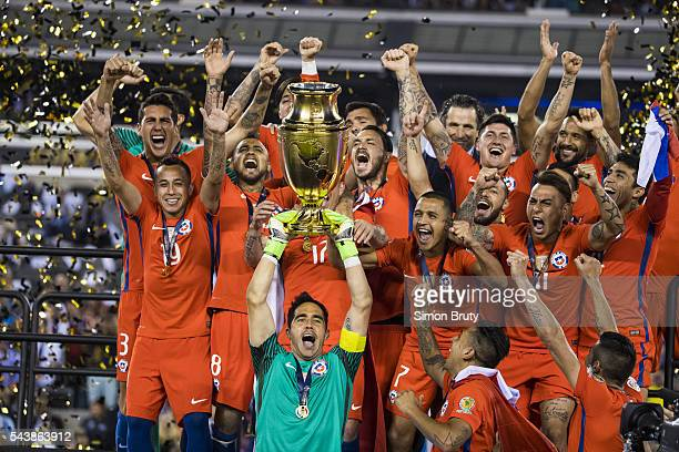 Copa America Chile players victorious with trophy during presentation ceremony after winning tournament final against Argentina at MetLife Stadium...