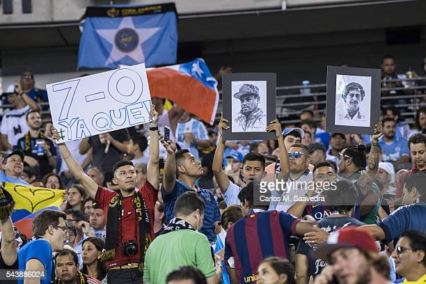 Copa America Fans holding El Chapo and Pablo Escobar portraits during Argentina vs Chile final match at MetLife Stadium East Rutherford NJ CREDIT...
