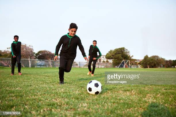 soccer develops agility, speed and stamina - friendly match stock pictures, royalty-free photos & images