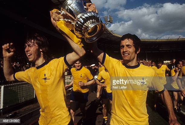 FA Cup Final Arsenal FC Charlie George and captain Frank McLintock and victorious carrying the FA Cup trophy after winning game vs Liverpool FC at...