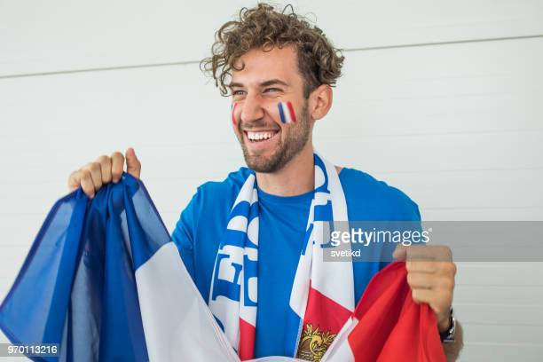 soccer fan cheering for national team at the game - sciarpa foto e immagini stock