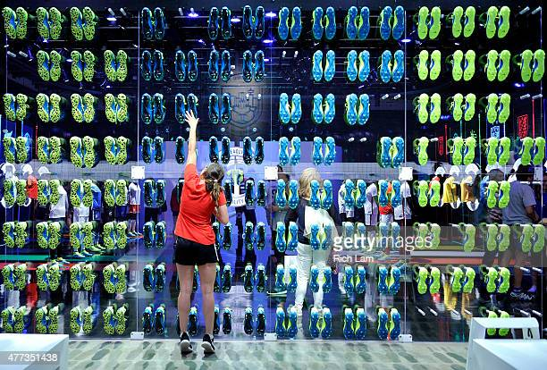 A soccer fan grabs a shoe at The Nike Underground a popup experience in downtown Vancouver before the Group D match of the FIFA Women's World Cup...