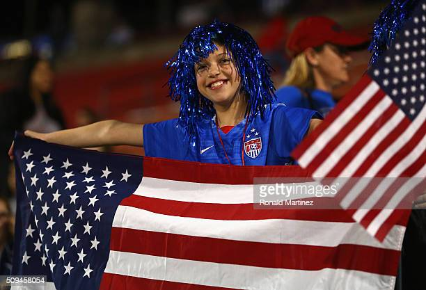 Soccer fan holds up a flag during a match between USA and Costa Rica during the 2016 CONCACAF Women's Olympic Qualifying at Toyota Stadium on...