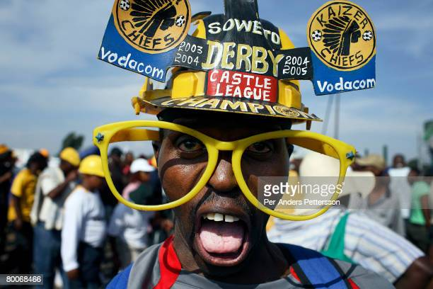 A soccer fan leaves a game on December 9 2006 in Soweto Johannesburg South Africa He attended a derby between the archrivals Orlando Pirates and...