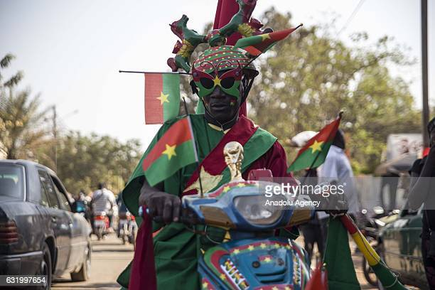 Soccer fan of Burkina Faso is seen ahead of his national team's match against Gabon on television, during 2017 Africa Cup of Nations, in Ouagadougo,...