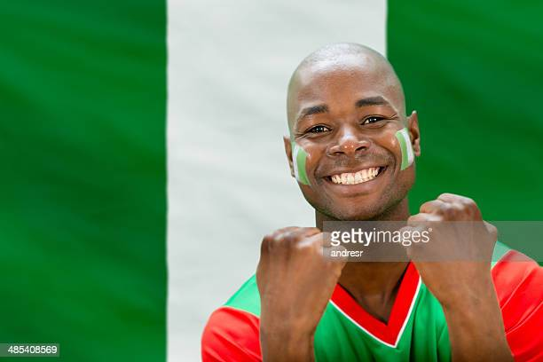 soccer fan - nigerian flag stock photos and pictures