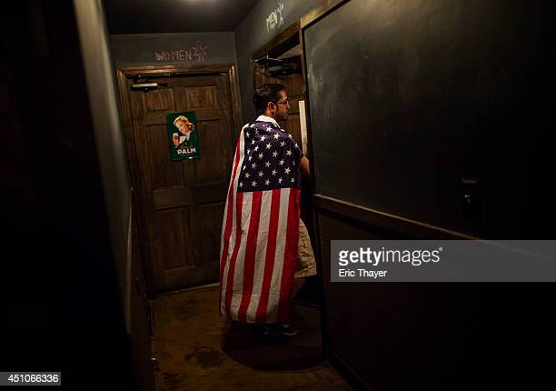 A soccer fan takes a break from watching the US play a World Cup Group G match against Portugal at Berry Park bar June 22 2014 in the Brooklyn...