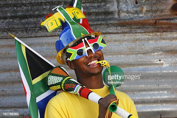 soccer fan with vuvuzela and makaraba - south african culture stock photos and pictures