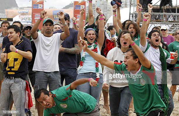 Soccer fans and Mexican supporters celebrate a scored goal by Mexico during the opening match against South Africa as part of FIFA World Cup at FIFA...