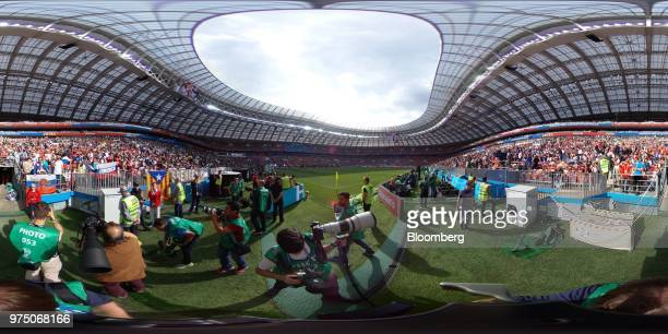 Soccer fans and the broadcast media prepare for the opening ceremony of the FIFA World Cup in the Luzhniki stadium in Moscow Russia on Thursday June...