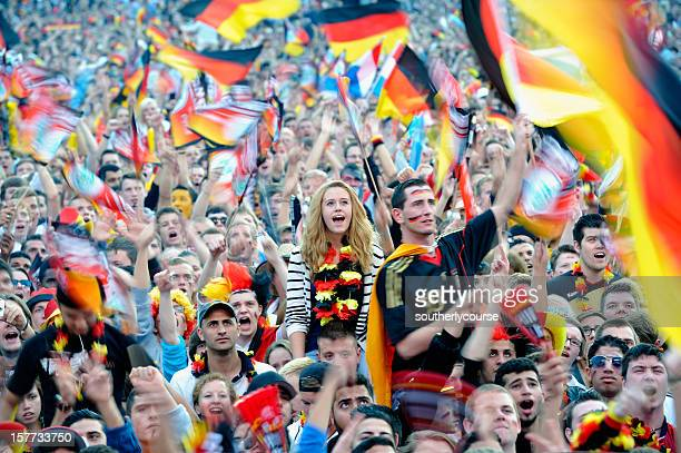 soccer fans at public viewing area brandenburger tor - germany stock pictures, royalty-free photos & images
