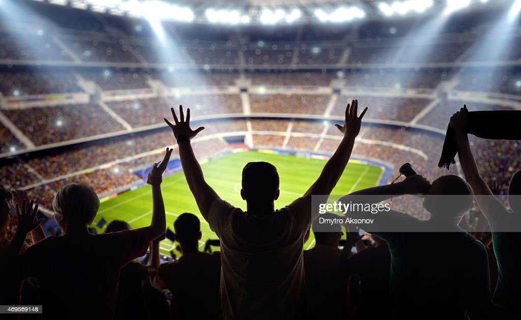 Soccer fans at stadium : Stock Photo