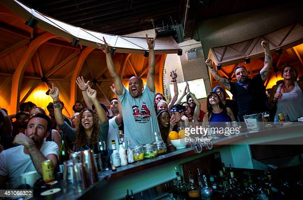 Soccer fans cheer as the US plays a World Cup Group G match against Portugal at Kinfolk bar June 22 2014 in the Brooklyn borough of New York City...