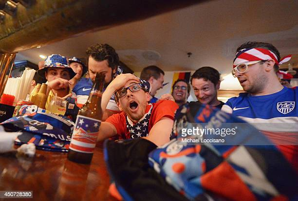 Soccer fans cheer for team USA as they face Ghana during the World Cup in Brazil at Jack Demsey's bar on June 16 2014 in New York City