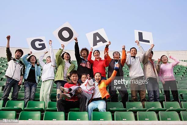 Soccer Fans Cheering at Stadium