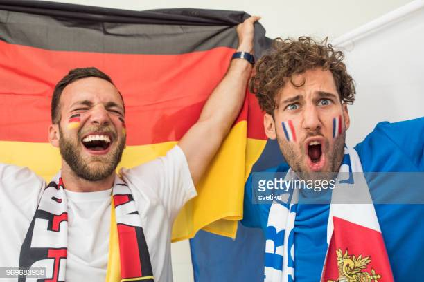 soccer fans cheering for national teams at world cup championship - northern european descent stock pictures, royalty-free photos & images