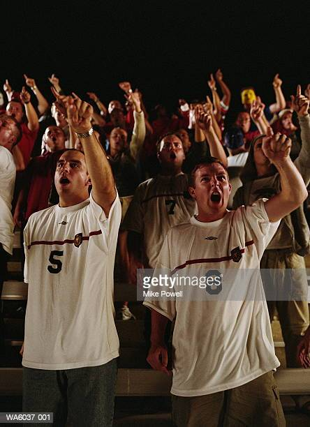 Soccer fans cheering from stands