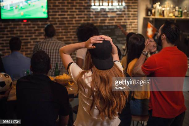 soccer fans cheering - pub stock pictures, royalty-free photos & images