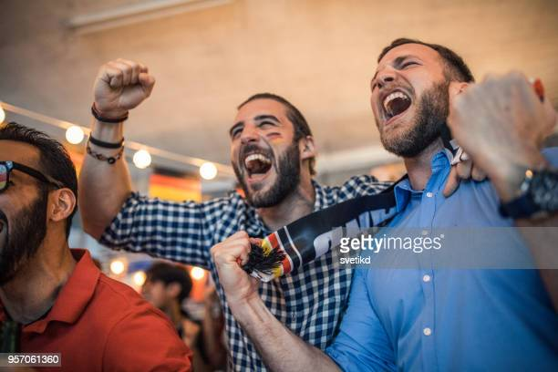 soccer fans cheering - mens world championship stock photos and pictures