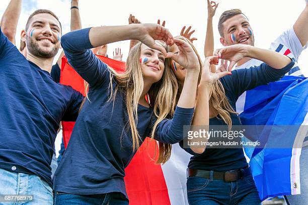 soccer fans forming heart with hands - french football photos et images de collection