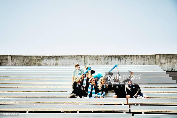 soccer fans in empty stadium taking selfie - fan enthusiast imagens e fotografias de stock