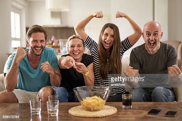 soccer fans in front of tv