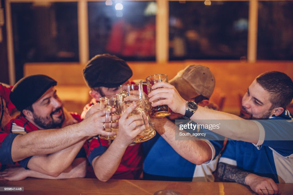 Soccer fans in sports pub : Stock Photo