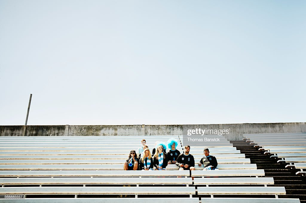 Soccer fans in stadium before crowd arrives : Stock Photo