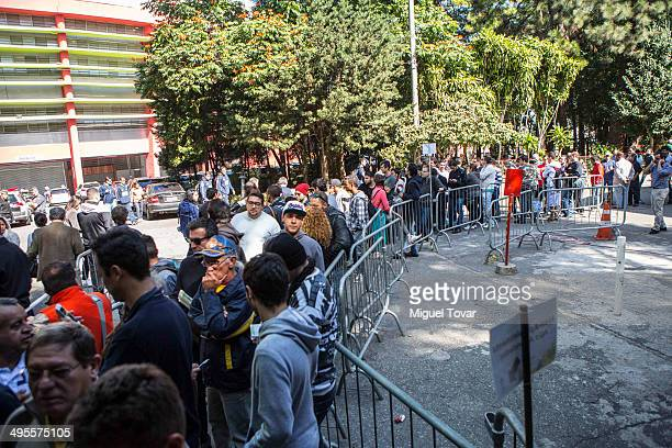Soccer fans line up outside the Ibirapuera Gym hoping to buy tickets for a FIFA World Cup 2014 match in Sao Paulo on June 04 2014 in Sao Paulo Brazil...