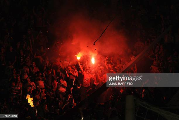 Soccer fans react during the Flamengo versus Caracas Copa Libertadores match in Caracas on March 10 2010 AFP PHOTO / JUAN BARRETO