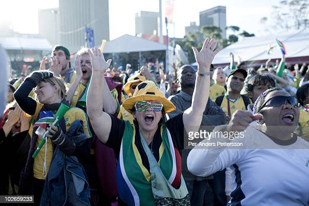 Soccer fans react to a game between South Africa and France shown on giant monitors on June 22 in central Cape Town South Africa Thousands of fans...