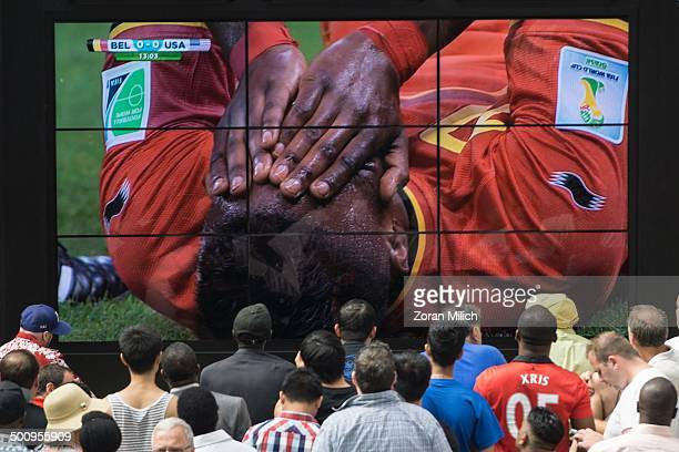 Soccer fans watch a FIFA World Cup match between Belgium and the United States at The Eatons Centre Mall July 1 2014 in Toronto Ontario Canada