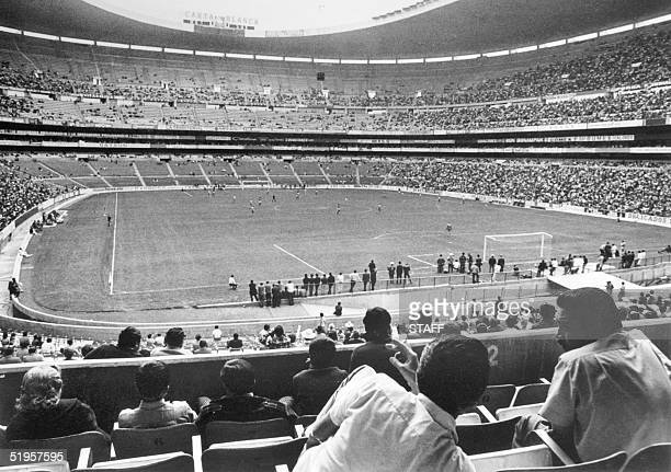 Soccer fans watch a match in progress 21 April 1970 at the Azteca stadium in Mexico City The stadium which has a capacity of 110000 spectators will...