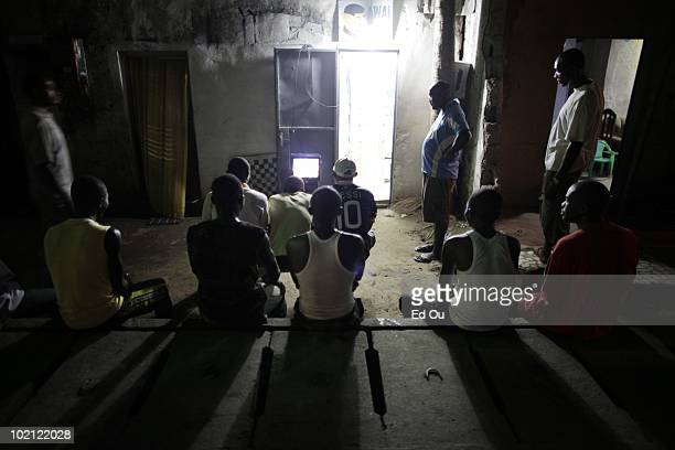 Soccer fans watch Inter Milan and Bayern Munich compete in the Champions League final on live television May 22 2010 in Douala Cameroon Inter Milan...