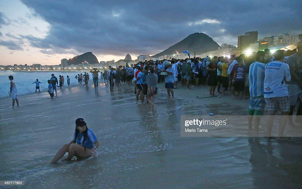 Soccer fans watch on Copacabana Beach during the 2014 FIFA World Cup final match pitting Argentina against Germany on July 13, 2014 in Rio de Janeiro, Brazil. Germany won the match 1-0 in extra time at the famed Maracana stadium.