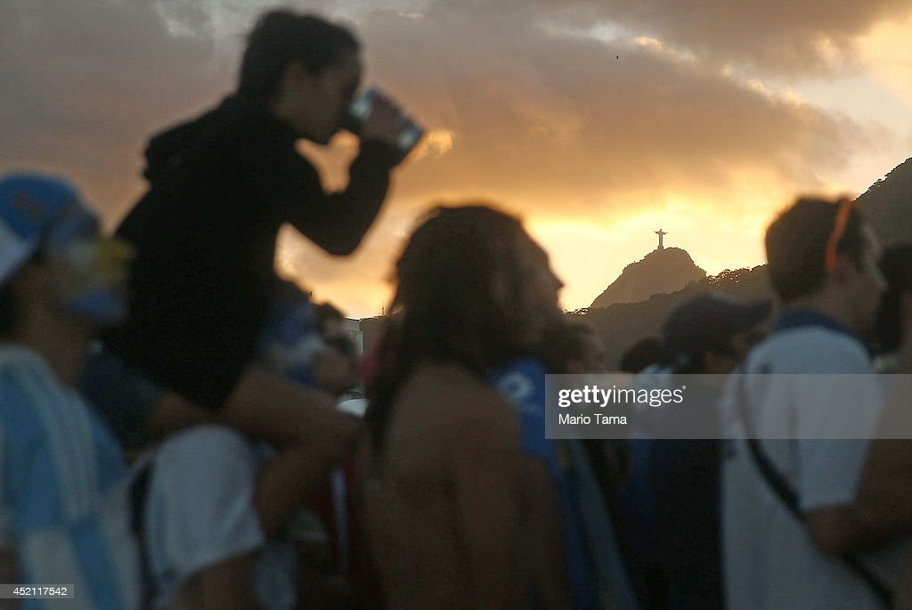 Soccer fans watch on Copacabana Beach in front of Christ the Redeemer statue during the 2014 FIFA World Cup final match pitting Argentina against Germany on July 13, 2014 in Rio de Janeiro, Brazil. Germany won the match 1-0 in extra time at the famed Maracana stadium.