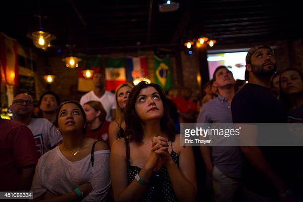 Soccer fans watch the US play a World Cup Group G match against Portugal at Berry Park bar June 22 2014 in the Brooklyn borough of New York City...