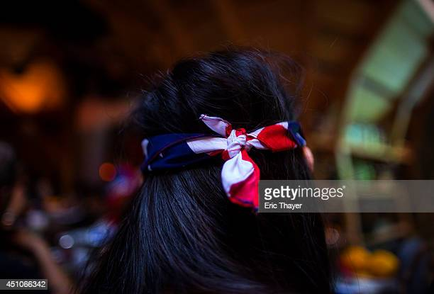 Soccer fans watch the US play a World Cup Group G match against Portugal at Kinfolk bar June 22 2014 in the Brooklyn borough of New York City...
