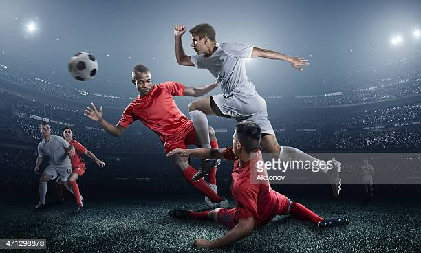 Soccer fans with many players aiming for the ball