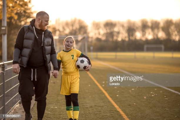 soccer father sports chaperone - daughter stock pictures, royalty-free photos & images