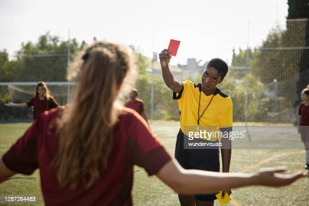 soccer female referee shows red card to female soccer player - referee stock pictures, royalty-free photos & images