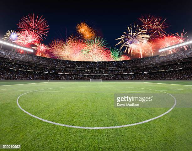 soccer field and stadium with fireworks. - fifa world cup stock pictures, royalty-free photos & images